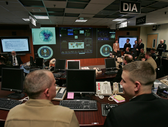 Experts man their stations at the Threat Operations Center inside the National Security Agency (NSA) in suburban Fort Mead, Maryland (AFP Photo)