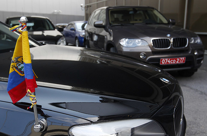 Two cars of the embassy of Ecuador in Moscow are parked outside the terminal where Edward Snowden, the former contractor for the U.S. National Security Agency, is believed to have landed in Moscow's Sheremetyevo airport, June 23, 2013. (Reuters / Maxim Shemetov)