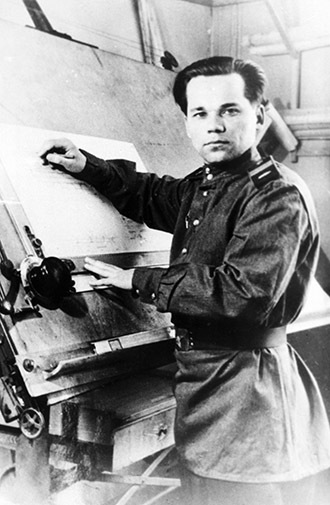 Senior Sergeant Mikhail Kalashnikov as he designed his AK-47 assault rifle, 1947 (RIA Novosti)