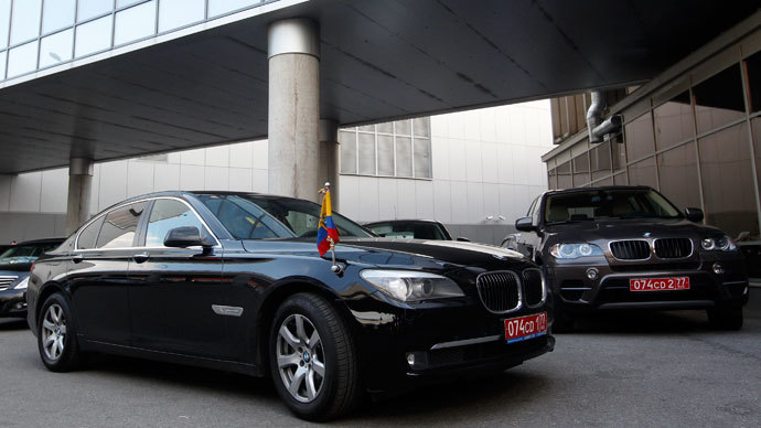 Two cars of the embassy of Ecuador in Moscow are parked outside the terminal where Edward Snowden, the former contractor for the U.S. National Security Agency, is believed to have landed in Moscow's Sheremetyevo airport, June 23, 2013.(Reuters / Maxim Shemetov)