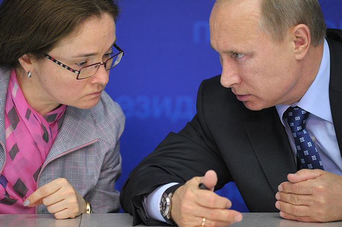 Russian President Vladimir Putin and Elvira Nabiullina having a conversation at meeting. (RIA Novosti / Alexei Druzhinin)