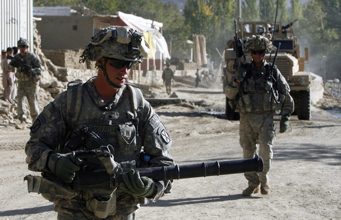 Soldiers from the U.S. Army's Bravo Company, 1 battalion, 32nd Infantry, of the 10th Mountain Division based in Fort Drum, New York, patrol in Pengram district, Logar province (Reuters)