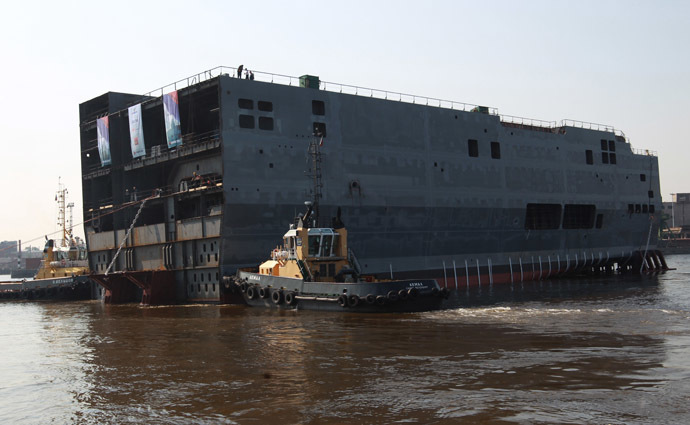 "Launching the stern of the first Russian Mistral type dock assault helicopter carrier ""Vladivostok"" at the Baltic Shipyard. (RIA Novosti)"