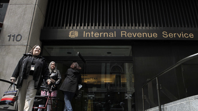 Women walk out of an Internal Revenue Service office in New York (Reuters)