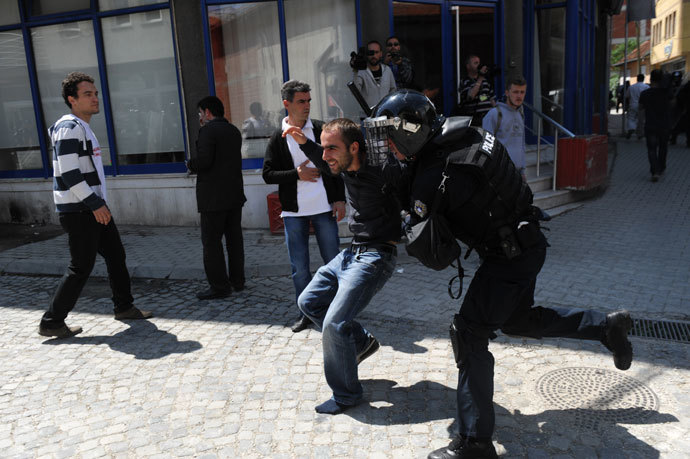 Kosovo Police detain a demonstrator following clashes in Pristina on June 27, 2013.(AFP Photo / Armend Nimani)