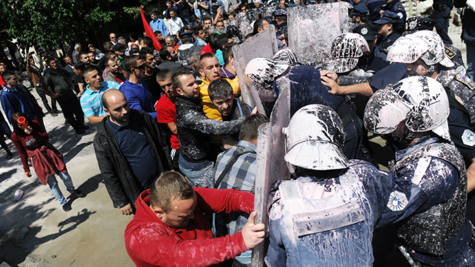Kosovo Police splashed with paint clash with demonstrators in Pristina on June 27, 2013.(AFP Photo / Armend Nimani)