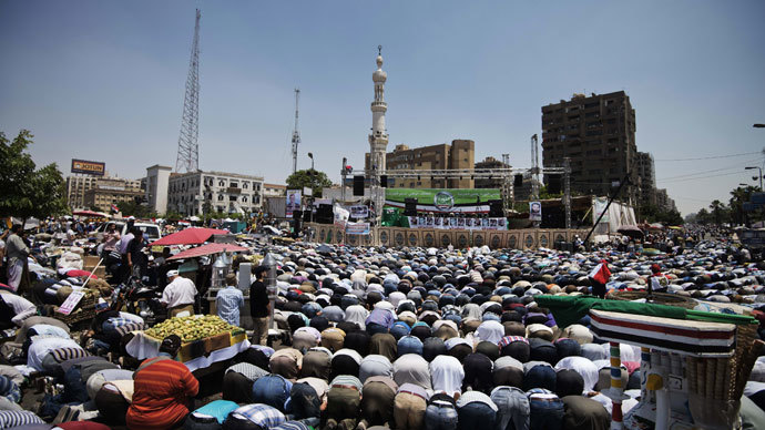Thousands of Islamists and Muslim Brotherhood supporters perform the Friday prayers as they gather at Rabaa al-Adawiya mosque to start an open-ended sit-in in support of the legitimacy of President Mohamed Morsi in Cairo on June 28, 2013.(AFP Photo / Gianluigi Guercia)