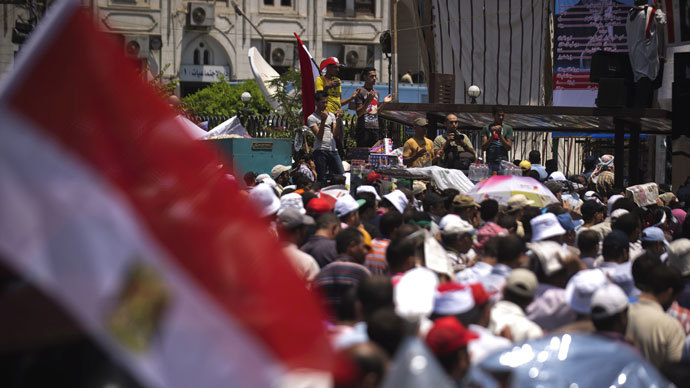 Islamists and Muslim Brotherhood supporters perform Friday prayers at Rabaa El-Adaweya mosque as thousands gather to start an open-ended sit in to show their support for the legitimacy of Egyptian President Mohammed Morsi on June 28, 2013 in the capital Cairo.(AFP Photo / Gianluigi Guercia)