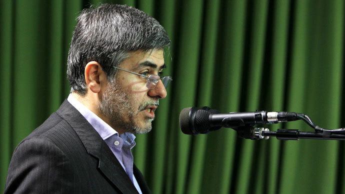 Leader Ayatollah Ali Khamenei shows the head of the Iranian Atomic Energy Organization Fereydoun Abbasi Davani.(AFP Photo / HO)