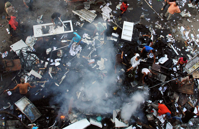 A scene of the aftermath of a fire that was set in the headquarters of the Freedom and Justice Party by anti-Mursi protesters during clashes between them and supporters of Egyptian president Mohamed Mursi in Sedy Gaber in Alexandria, June 28, 2013 (Reuters / Stringer)