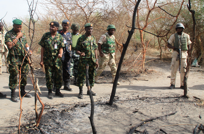 Members of the Nigerian Defence headquarter team inspecting an alleged Boko Haram base in Kirenowa (AFP Photo)