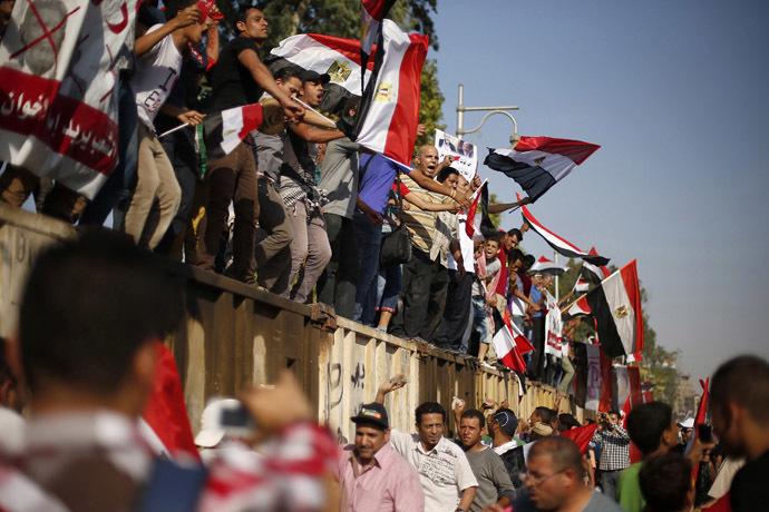 Protesters opposing Egyptian President Mohamed Morsi waves Egyptian flags during a protest in front of the presidential palace in Cairo June 30, 2013. (Reuters/Suhaib Salem)