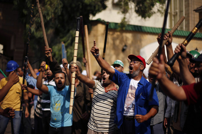 Supporters of Egyptian President Mohamed Morsi shout slogans during a protest around the Raba El-Adwyia mosque square in Nasr City, a suburb of Cairo, June 30, 2013 (Reuters)