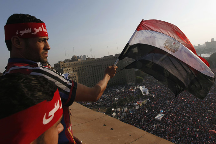 Protesters wave Egyptian flags as demonstrators opposing Egyptian President Mohamed Morsi shout slogans against him and Brotherhood members during a protest at Tahrir Square in Cairo June 30, 2013. (Reuters/Mohamed Abd El Ghany)