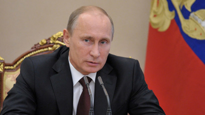 Putin signs law banning gay couples from adopting