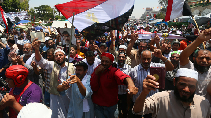 Supporters of Egypt's deposed president Mohamed Morsi chant islamic slogans during a rally outside Cairo's Rabaa al-Adawiya mosque on July 13, 2013 (AFP Photo)