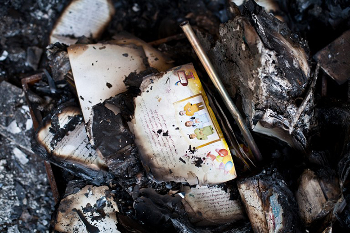 A picture taken on August 18, 2013 shows burnt books in the Amir Tadros coptic Church in Minya, some 250 kms south of Cairo, which was set ablaze on August 14, 2013. (AFP Photo / Virginie Nguyen Hoang)
