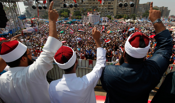 Clerics supporting deposed Egyptian President Mohamed Mursi attend a rally at the Raba El-Adwyia square where Mursi's supporters are camping, in Cairo August 2, 2013 (Reuters / Mohamed Abd El Ghany)