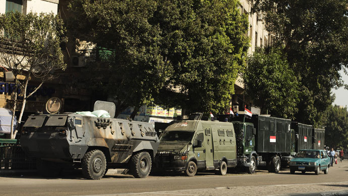 Trucks and APC's of Egyptian riot police are parked in the main street leading to Egypt's landmark Tahrir square on August 20, 2013 in Cairo, Egypt.(AFP Photo / Gianluigi Guercia)