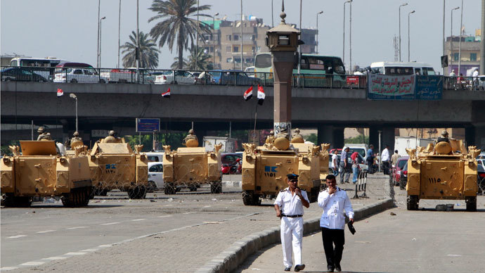Egyptian army soldiers guard with armoured personnel carriers (APC) near Tahrir Square in Cairo August 19, 2013.(Reuters / Mohamed Abd El Ghany)
