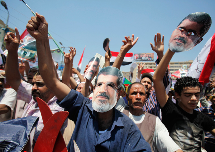 Members of the Muslim Brotherhood and supporters of ousted Egyptian President Mohamed Mursi shout slogans during a rally around Rabaa Adawiya square where they are camping, in Cairo July 26, 2013 (Reuters / Amr Abdallah Dalsh)