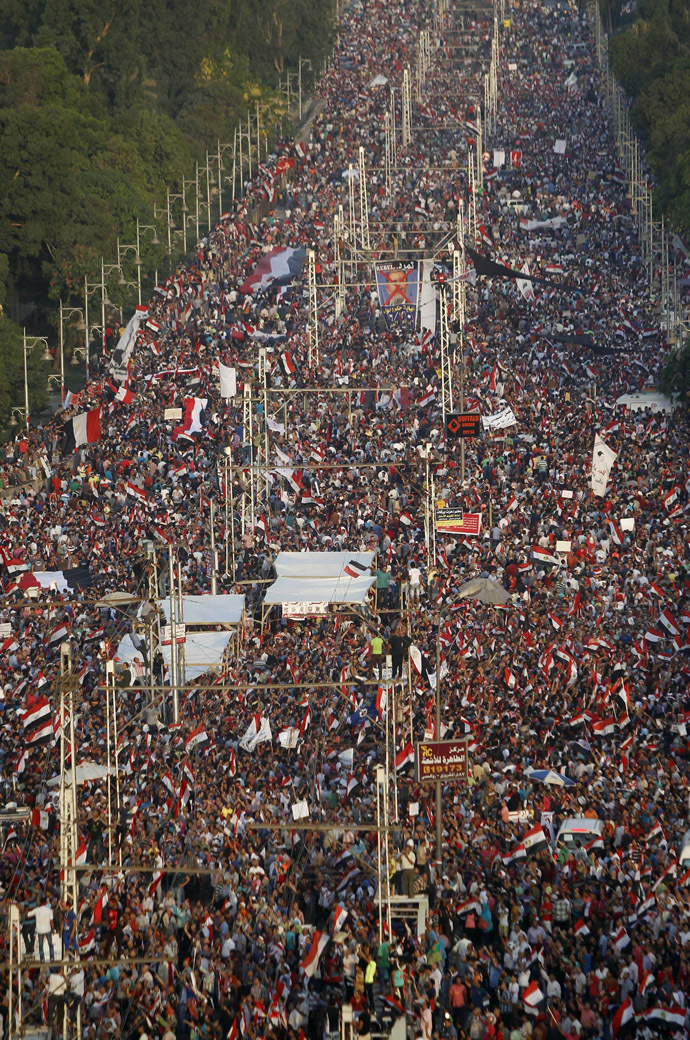 A general view of protesters opposing Egyptian President Mohamed Mursi waving Egyptian flags and shouting slogans against him and members of the Muslim Brotherhood, during a protest in front of El-Thadiya presidential palace in Cairo June 30, 2013. (Reuters)