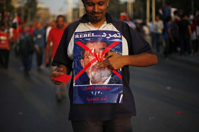 'Biggest protest in Egypt's history': LIVE UPDATES Ca-13