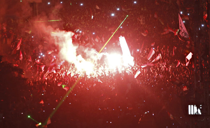 Protesters opposing Egyptian President Mohamed Mursi shout slogans and set off fireworks during a protest in front of El-Thadiya presidential palace in Cairo June 30, 2013. (Reuters)