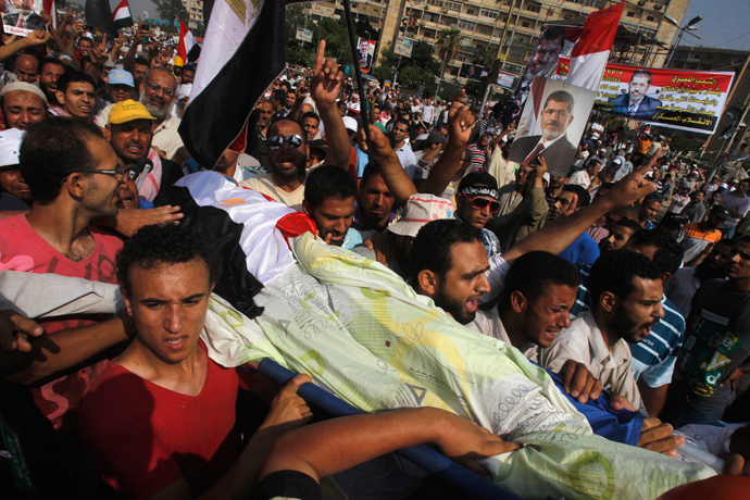 People celebrate at Tahrir Square after a broadcast by the head of the Egyptian military confirming that they will temporarily be taking over from the country's first democratically elected president Mohammed Morsi on July 3, 2013 in Cairo (AFP Photo / Khaled Desouki)