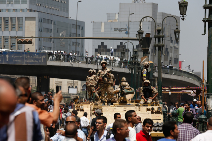 Soldiers stand guard on an armoured personnel carrier positioned outside Ramses Square, near al-Fath mosque in Cairo August 17, 2013 (Reuters / Youssef Boudlal)