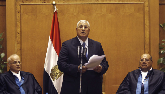 Adli Mansour (C), Egypt's chief justice and head of the Supreme Constitutional Court, speaks at his swearing in ceremony as the nation's interim president in Cairo July 4, 2013, a day after the army ousted Mohamed Morsi as head of state. (Reuters/Amr Abdallah Dalsh)