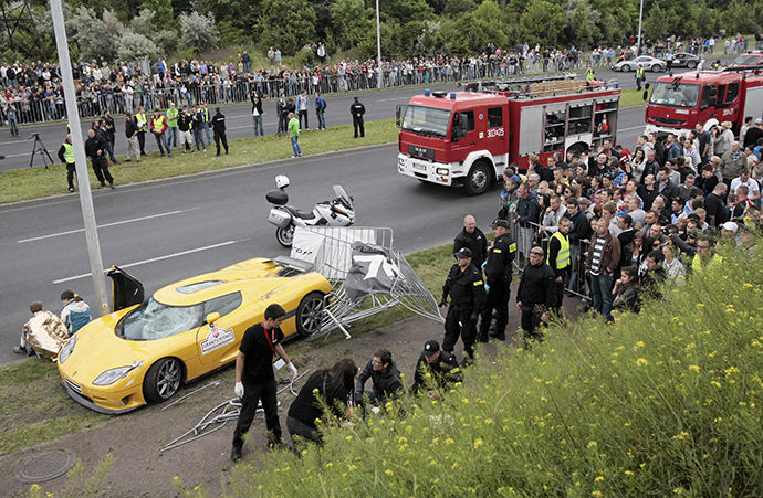 Emergency service workers help people wounded in an accident at Gran Turismo Polonia in Poznan June 30, 2013. (Reuters / Agencja Gazeta)