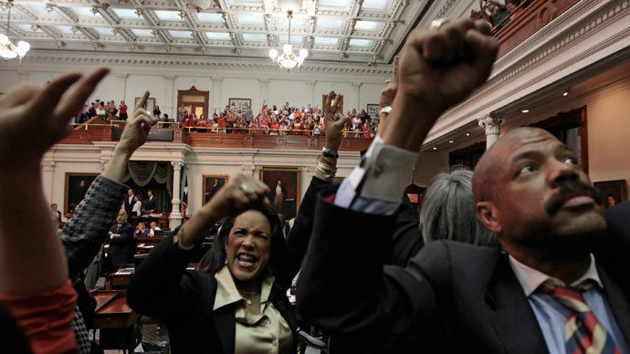 State Rep. Donna Dukes (D-Austin) (L) cheers with reproductive rights advocates as the Texas Senate tries to vote on the controversial anti-abortion bill SB5, which was up for a vote on the last day of the legislative special session June 25, 2013 in Austin, Texas.(AFP Photo / Erich Schlegel)