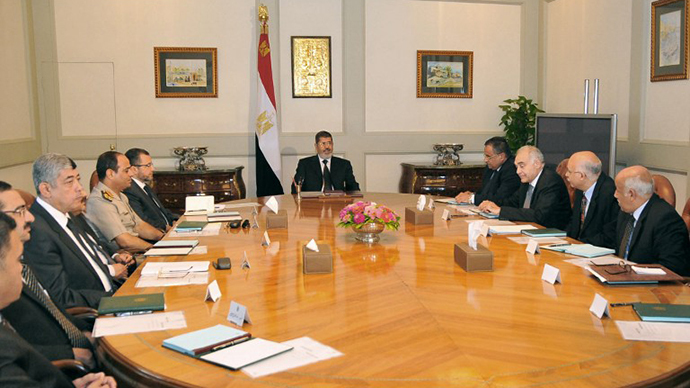 Egypt's President Mohammed Morsi holding a meeting on national security in Cairo (AFP Photo / Egyptian Presidency)