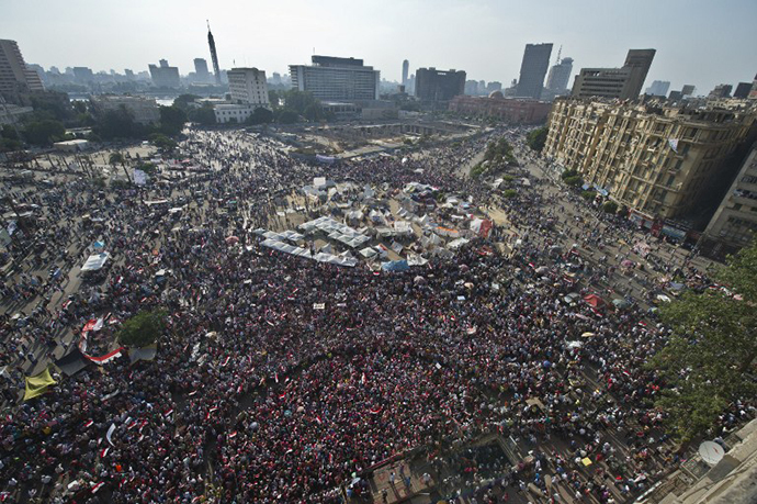 Opponents of Egyptian President Mohamed Morsi gather during a protest calling for his ouster at Cairo's landmark Tahrir Square, on July 2, 2013. (AFP Photo / Khaled Desouki)