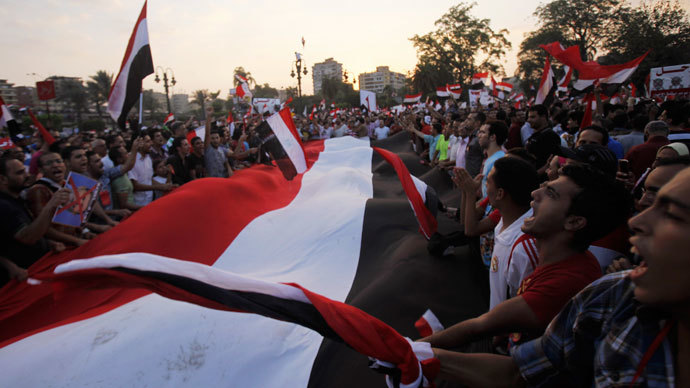 """Protesters opposing Egyptian President Mohamed Mursi shout slogans during a demonstration in front of the Presidential Palace """"Qasr Al Quba"""" in Cairo July 2, 2013.(Reuters / Amr Abdallah Dalsh)"""