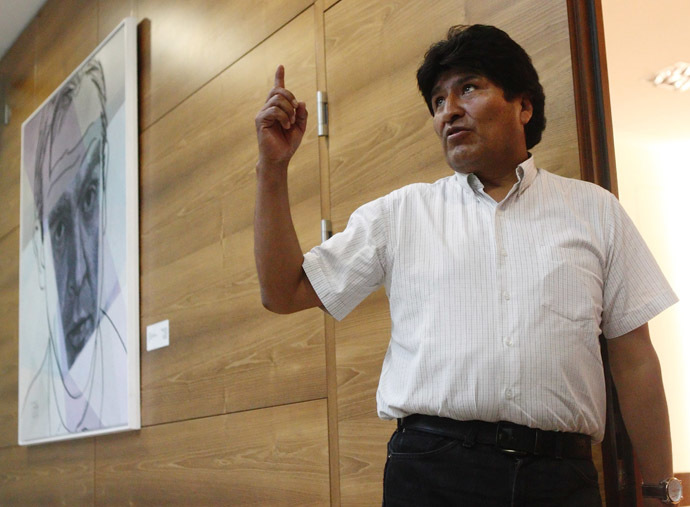 Bolivian President Evo Morales talks to the media as he waits for his flight at the Vienna International Airport in Schwechat July 3, 2013. (Reuters)