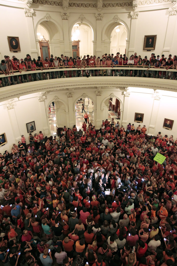 Reproductive rights advocates fill the Texas capitol rotunda celebrating the defeat of the controversial anti-abortion bill SB5, which was up for a vote on the last day of the legislative special session June 25, 2013 in Austin, Texas. (Erich Schlegel/Getty Images/AFP)