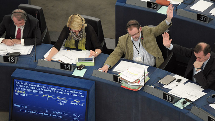 Members of the EU Parliament take part in a voting session on the implications for EU citizens' privacy of the US Prism and other internet surveillance cases, on July 4, 2013 during a session of the European Parliament in Strasbourg, eastern France. (AFP Photo/Frederick Florin)