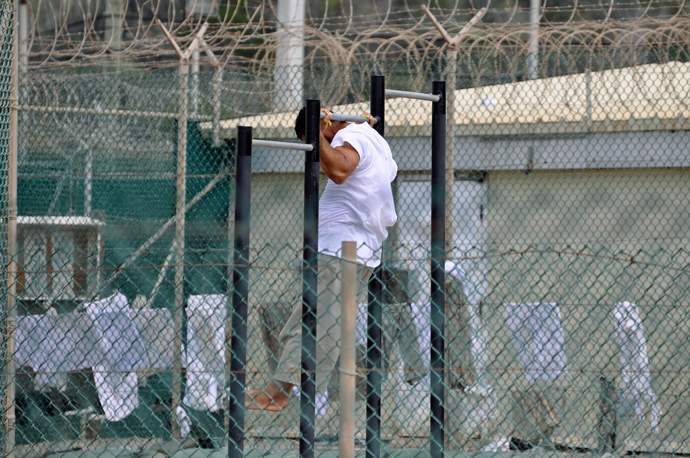 Guantanamo detainee does pull-ups inside an exercise area at the detention facility at Guantanamo Bay U.S. Naval Base (Reuters / Michelle Shephard / Pool)