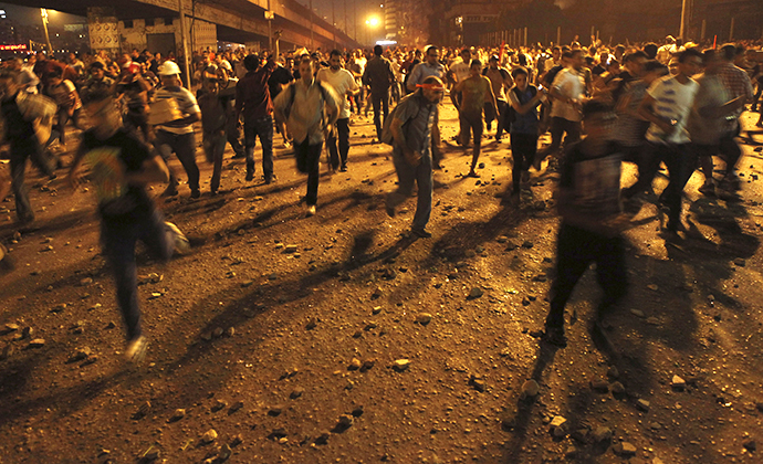 Anti-Mursi protesters run during clashes with members of the Muslim Brotherhood and supporters of ousted Egyptian President Mohamed Mursi near Maspero, Egypt's state TV and radio station, near Tahrir square in Cairo July 5, 2013. (Reuters / Amr Dalsh)
