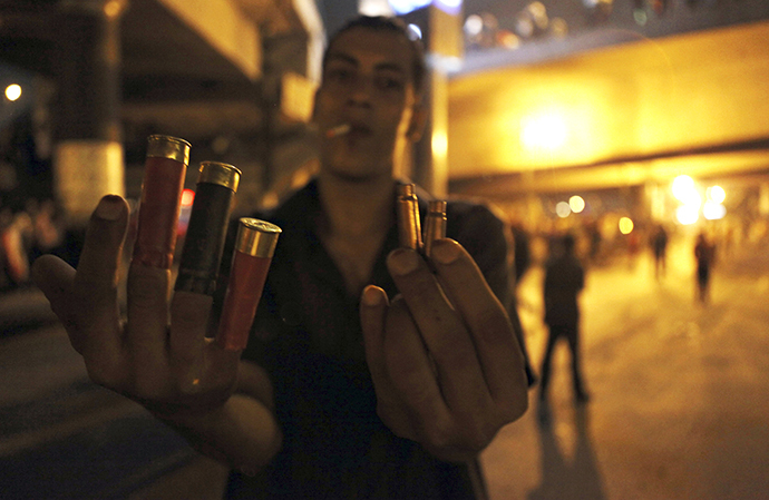 An anti-Mursi protester shows spent shell casings and rubber bullets during clashes with members of the Muslim Brotherhood and supporters of ousted Egyptian President Mohamed Mursi near Maspero, Egypt's state TV and radio station, near Tahrir square in Cairo July 5, 2013. (Reuters / Amr Dalsh)