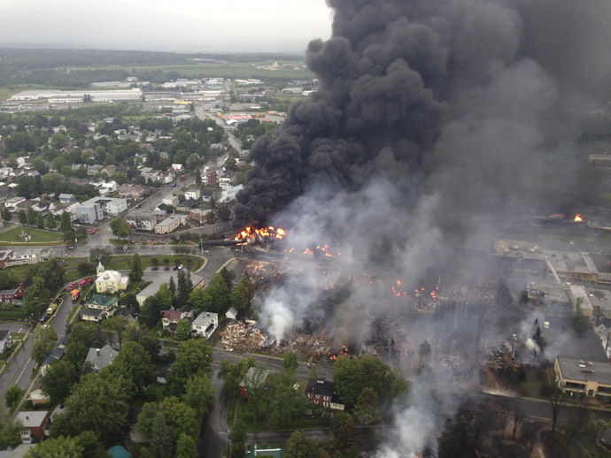 Smoke billows from a fire at the site of a train derailment in Lac Megantic, Quebec in this July 6, 2013 aerial handout photo. (Reuters/Surete du Quebec)