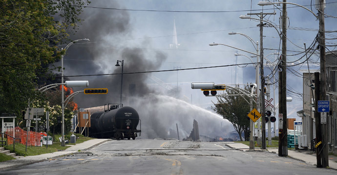 A burning train wagon is seen after an explosion at Lac Megantic, Quebec, July 6, 2013. (Reuters/Mathieu Belanger)