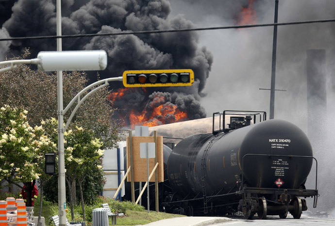 A burning train wagon is seen after an explosion at Lac Megantic, Quebec, July 6, 2013 (Reuters/Mathieu Belanger)