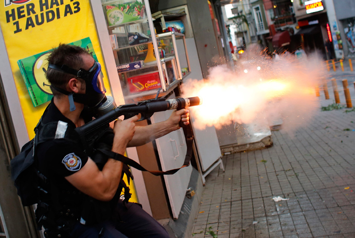 A riot policeman fires teargas during a protest in central Istanbul July 6, 2013 (Reuters / Murad Sezer)