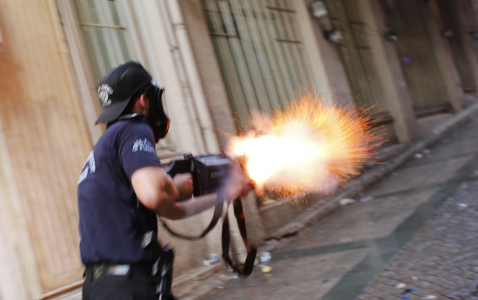 A riot policeman fires teargas during a protest in central Istanbul July 6, 2013. (Reuters/Murad Sezer)