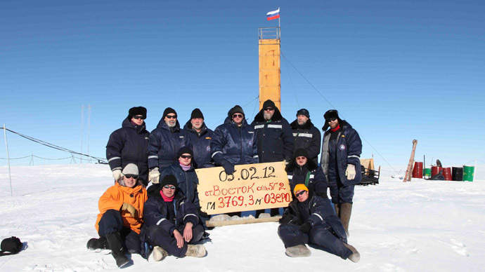 A handout photo provided by the Russia's Arctic and Antarctic Research Institute taken at the Vostok station in Antarctica on February 5, 2012, shows Russian researchers posing for a picture after reaching the subglacial lake Vostok (AFP Photo)