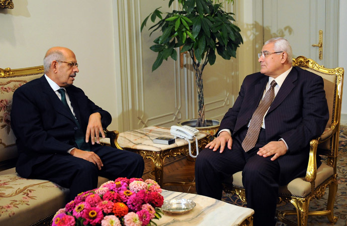 A handout picture released by the Egyptian Presidency shows Egypt's interim president Adly Mansour (R) meeting with newly appointed Prime Minister and opposition National Salvation Front leader Mohamed El Baradei (L) in Cairo on July 6, 2013. (AFP Photo/Egyptian Presidency)