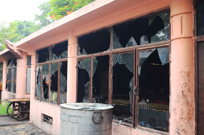 This image shows broken windows at the Bodh Gaya Buddhist temple complex after several low intensity explosions took place injuring two people on July 07,2013 (AFP Photo / STR)
